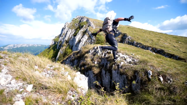 man jumping from rock to rock - climbing stock videos & royalty-free footage