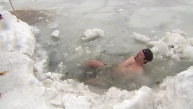 WGN Man Jumping Into Icy Water During Polar Plunge at North Avenue Beach on January 01 2014 in Chicago Illinois