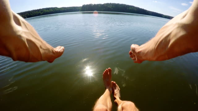 man jumping into lake with wearable camera. pov. summer activity - pier stock videos & royalty-free footage