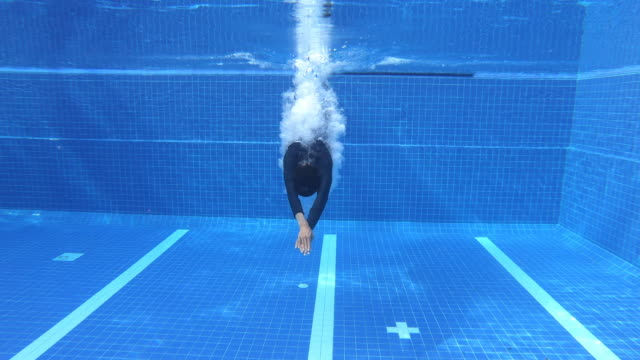 4k a man jumping into pool. - diving into water stock videos & royalty-free footage