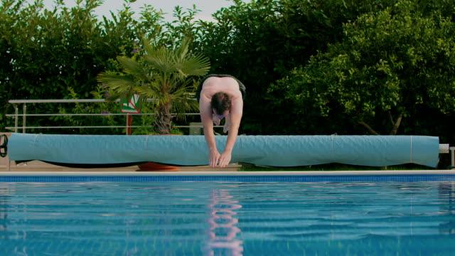 Man jumping into swimming pool