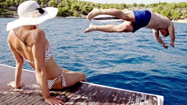 SLO MO Man jumping into the sea