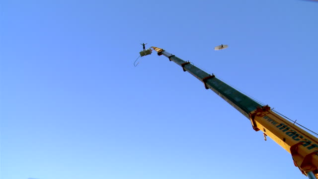 ms man jumping on bungee jumper from large construction crane / targu mures,  romania - mures stock videos and b-roll footage