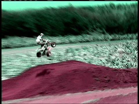 ws, pan, composite, cu, man jumping on quad bike on dirt track and crashing, people gathering around injured man, usa - film composite stock videos & royalty-free footage