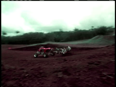 la, ws, pan, composite, ms,  man jumping on quad bike on dirt track and crashing, usa - film composite stock videos & royalty-free footage