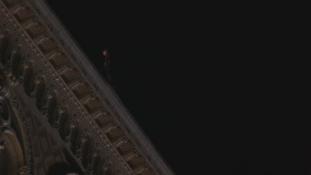 a man jumps from the roof of a building. - stunt person stock videos & royalty-free footage