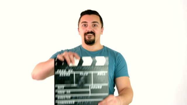 Man jumps in frame and uses movie film clapperboard or film slate