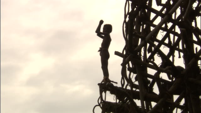 man jumps off wooden tower during land diving ritual, pentecost, vanuatu - pentecost stock videos and b-roll footage