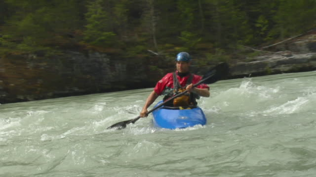 SLO MO WS Man kayaking down river / Squamish, BC, Canada