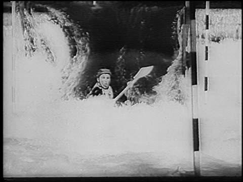 vídeos y material grabado en eventos de stock de man kayaking down small waterfall in slalom competition on rapids / germany / newsreel - sólo hombres jóvenes