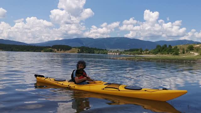 man kayaking in mountain lake. paddling and eco tourism. - eco tourism stock videos & royalty-free footage