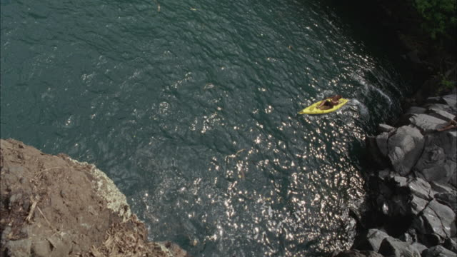 WS, HA, CANTED, Man kayaking near rocky shore, Maui, Hawaii, USA