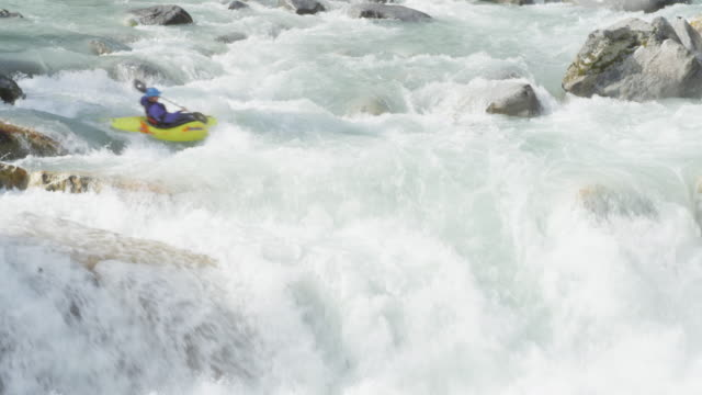 ms man kayaking off waterfall in white water rapids - sorte video stock e b–roll