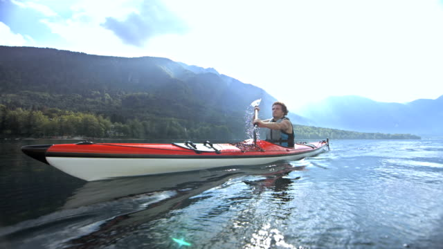 man kayaking on the lake - canoeing stock videos and b-roll footage