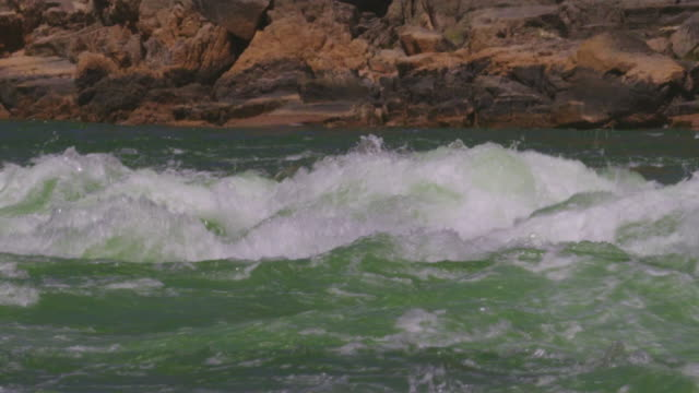 WS TS SLO MO Man kayaking through large rapid waves down Grand Canyon / Grand Canyon, Arizona, USA