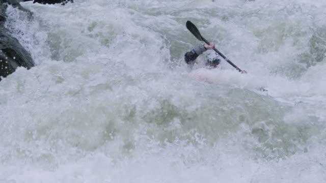 WS PAN SLO MO Man kayaking through large rapid waves down river / Tena, Napo, Ecuador