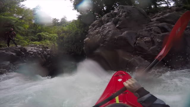 a man kayaks down a waterfall on a river. - kayak stock videos & royalty-free footage