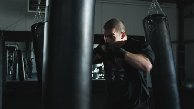 man kickboxing in a gym - kickboxing stock videos & royalty-free footage