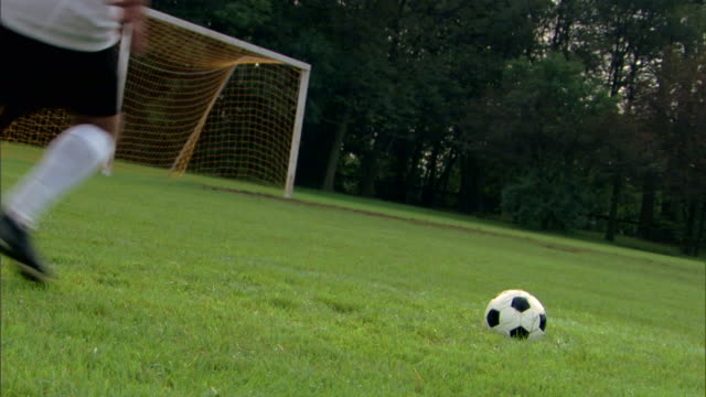 man kicking soccer ball into goal - see other clips from this shoot 1280 stock videos & royalty-free footage