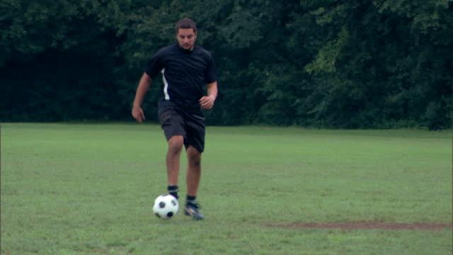 Man kicking soccer ball