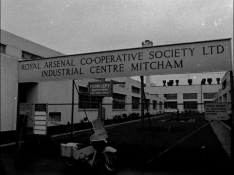man killed during coop robbery in south london england south london mitcham sign royal arsenal cooperative society ltd ms lorries in yard broadcast... - 1962 stock videos and b-roll footage