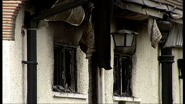 Man killed in New Malden house fire ENGLAND London New Malden EXT General views semidetached house destroyed by fire with burnt out roof windows...
