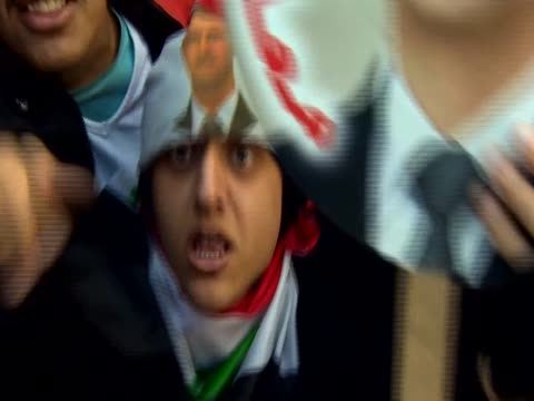 a man kisses a poster of bashar alassad during a rally in support of the syrian president - poster stock videos & royalty-free footage