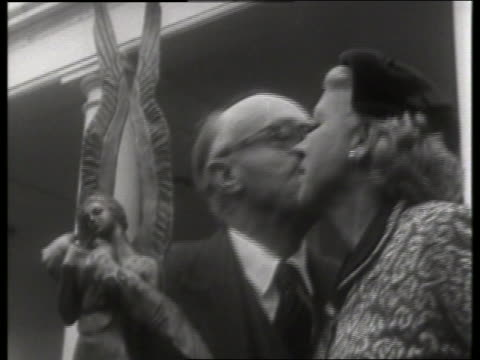 vídeos y material grabado en eventos de stock de man kissing jacqueline cochran with award / pilot / no sound - pareja de mediana edad