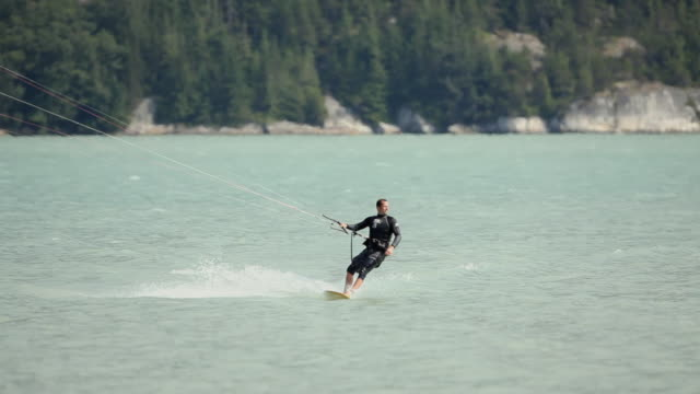 ws man kite boarding  / squamish, british columbia, canada - squamish stock videos & royalty-free footage