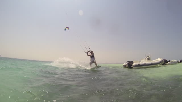 a man kite surfing on the red sea in egypt. - slow motion - rotes meer stock-videos und b-roll-filmmaterial