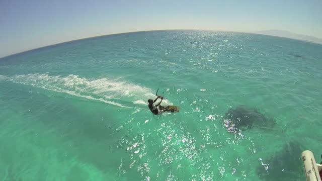 vídeos de stock, filmes e b-roll de a man kite surfing on the red sea in egypt. - slow motion - goodsportvideo