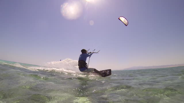 A man kite surfing on the Red Sea in Egypt. - Slow Motion