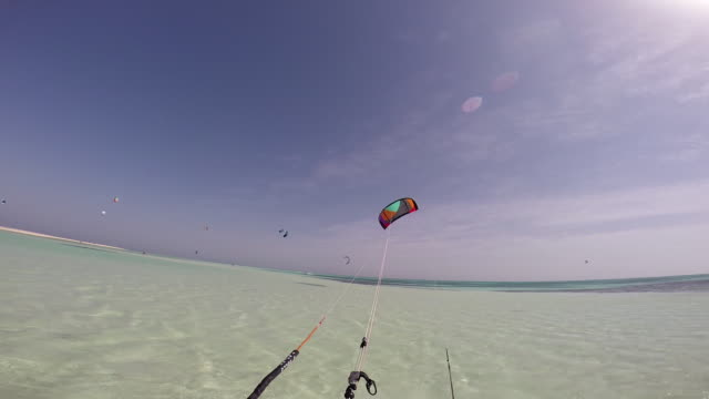 a man kite surfing on the red sea in egypt. - north africa stock videos & royalty-free footage