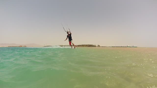 a man kite surfing on the red sea in egypt. - red sea stock videos & royalty-free footage