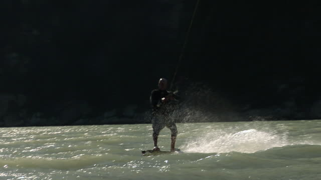 SLO MO WS TS Man kiteboarding in Howe Sound /  Sea-to-Sky Region, British Columbia, Canada