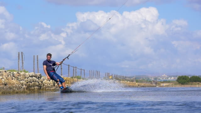 a man kiteboarding on a kite board. - goodsportvideo stock videos and b-roll footage