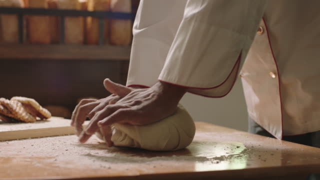 man kneading a dough - baking stock videos & royalty-free footage