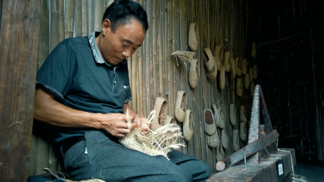 man knitting straw sandals,sichuan,china. - scratched stock videos & royalty-free footage