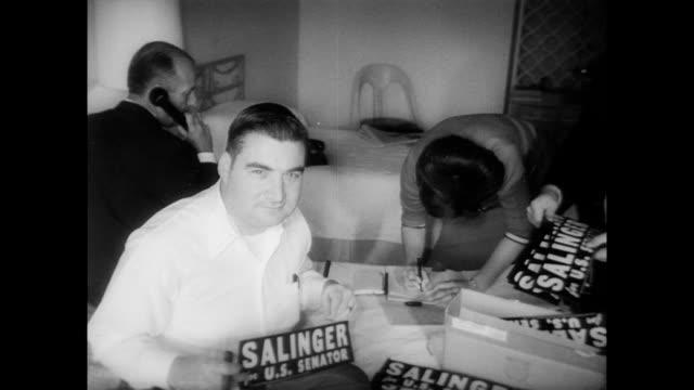 man knocking on door that is opened by pierre salinger / photographer takes close ups of salinger as he poses with bumper sticker / press aide andrew... - sticker stock videos and b-roll footage