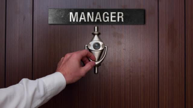 Man knocking on manager door