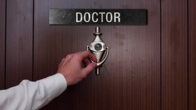 man knocking on the doctor door - clinic stock videos & royalty-free footage