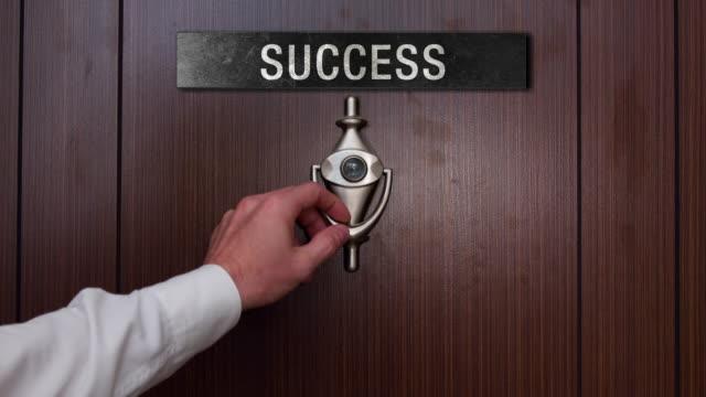 Man knocking on the success door