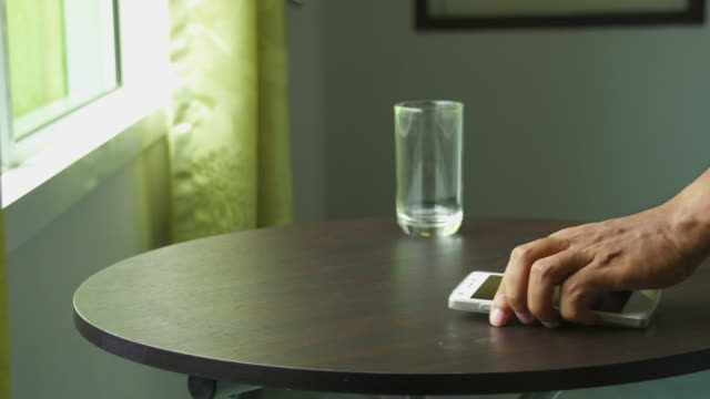 Man Lay Smart Phone On Table