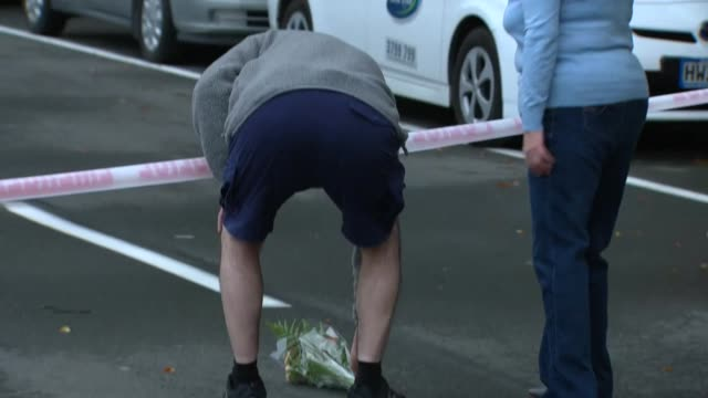 A man laying flowers near the Al Noor Mosque in Christchurch New Zealand after a white supremacist terrorist murdered 50 people during an attack on...