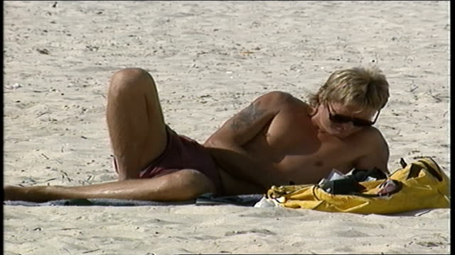 man laying on beach in perth australia - water sports equipment stock videos and b-roll footage