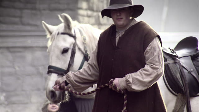 a man leads his horse through a busy london marketplace. - medieval stock videos & royalty-free footage