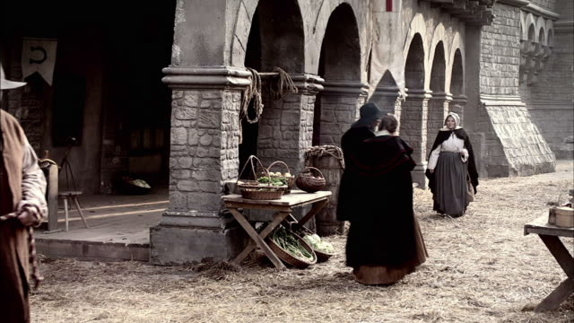 a man leads his horse through a london market. - medieval stock videos & royalty-free footage