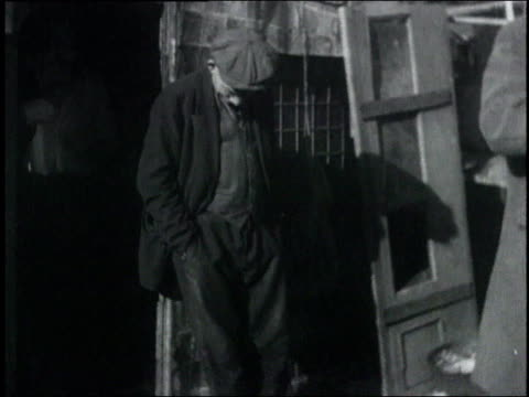 man leaning against wall with head down / usa - 1932 stock-videos und b-roll-filmmaterial
