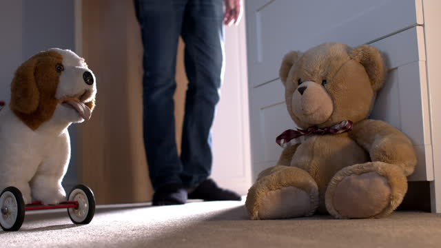 man leaving a child's bedroom. low angle shot with toys on the floor. - innocence stock videos & royalty-free footage