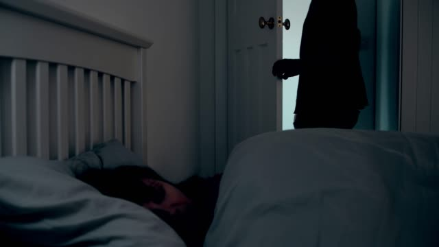 man leaving dark room, woman sleeping. - separation stock videos & royalty-free footage